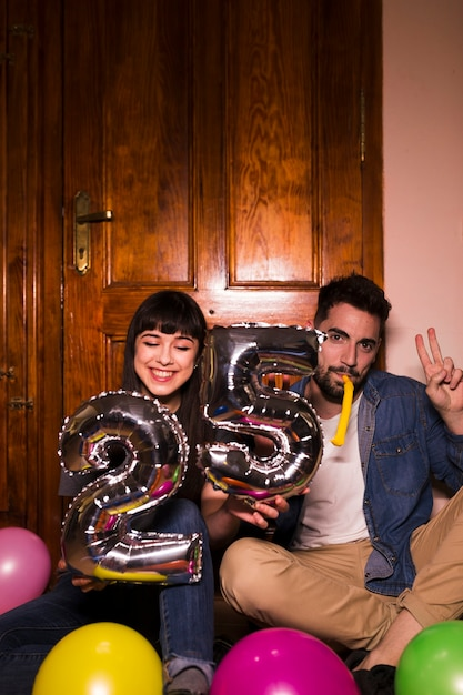 Young couple celebrating 25th birthday at home Free Photo