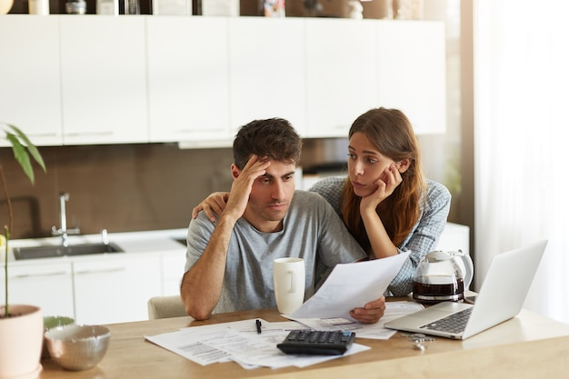 Young couple checking their family budget Free Photo