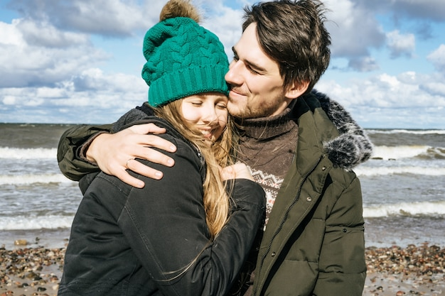 Free Photo | Young couple of the cold baltic sea