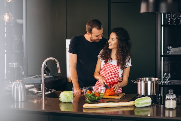 Young couple cooking together at the kitchen Free Photo