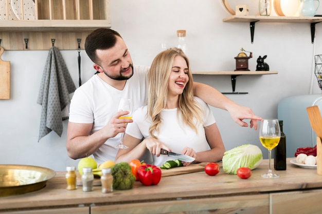 Young couple cooking together Free Photo