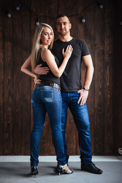 Young couple dancing latin music: bachata, merengue, salsa. two elegance pose on cafe with brick walls Premium Photo