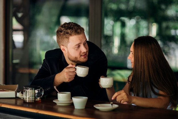 Young couple drinking tea in cafe Free Photo