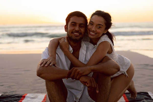Young couple embracing each other on the beach Free Photo