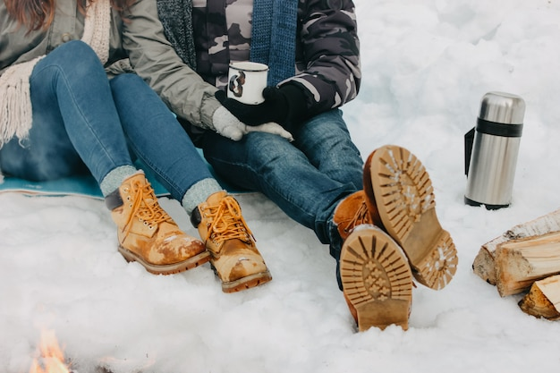 Young couple feet at the forest nature park in cold season. Premium Photo
