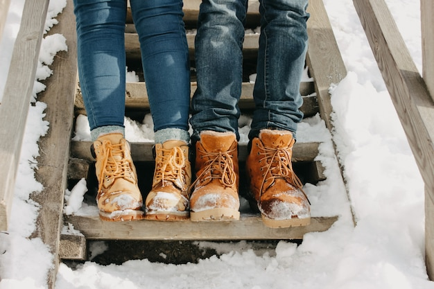 Young couple feet at park in cold season. Premium Photo