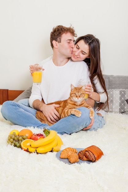 Young couple having breakfast in bed Free Photo