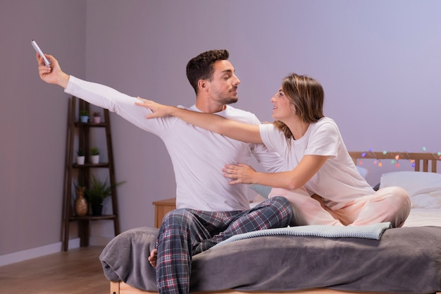 Young couple having fun in bedroom Free Photo