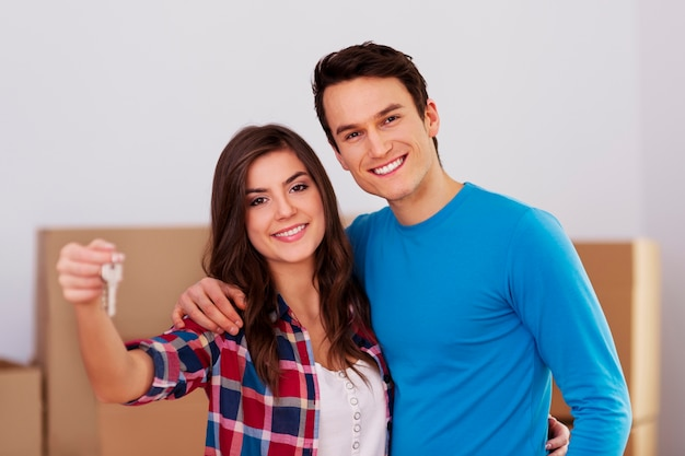 Young couple holding key in hand Free Photo