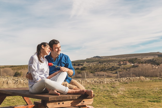 Young couple hugging and enjoying spending time together in the countryside Premium Photo