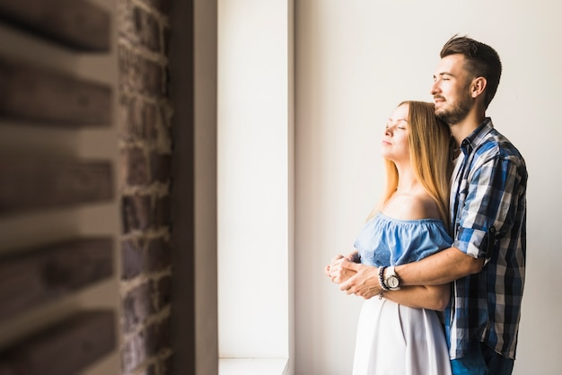Young couple hugging with closed eyes Free Photo