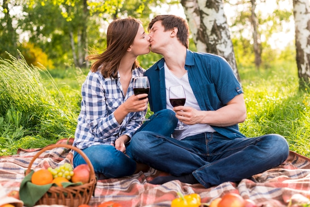 Young couple kissing on picnic Free Photo