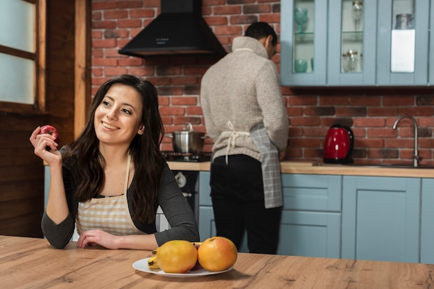 Young couple in the kitchen together Free Photo