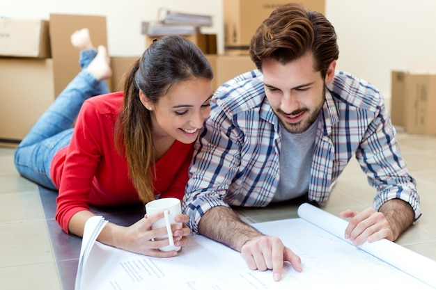 Young couple looking at the blueprints of their new home 1301 7587
