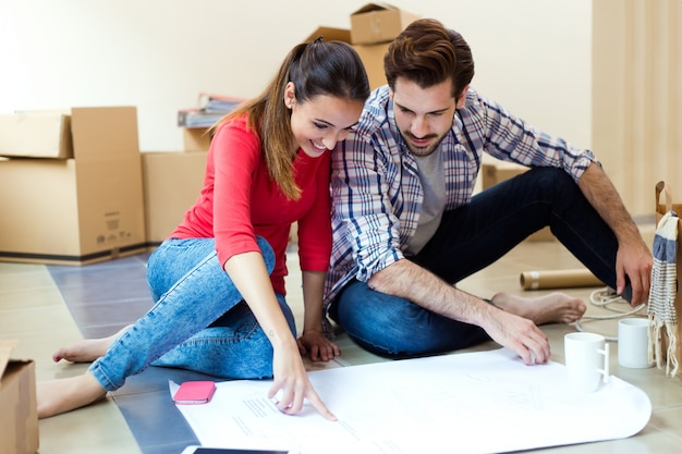Young couple looking at the blueprints of their new home 1301 7590