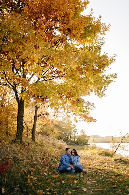 Young couple in love. a love story in the autumn forest park Free Photo
