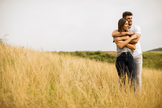 Young couple in love outside in spring nature Premium Photo