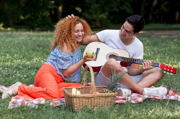 Young couple in love on picnic blanket Free Photo