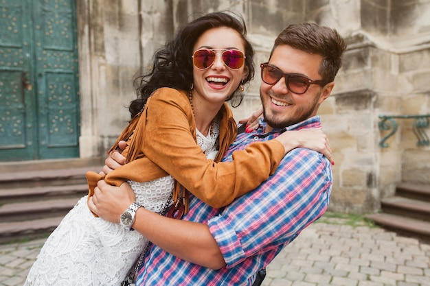 Young couple in love posing in old town Free Photo
