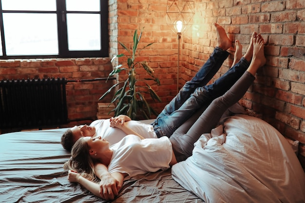 Young couple in love spending time together. beautiful woman and handsome man having intimate moments at home Free Photo