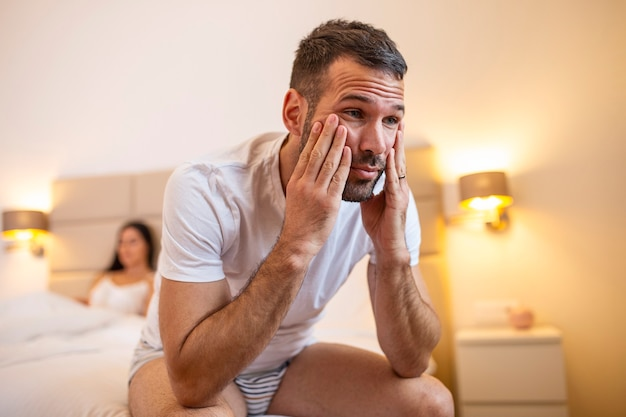 Young couple lying in bed frustrated thinking about relationships Premium Photo