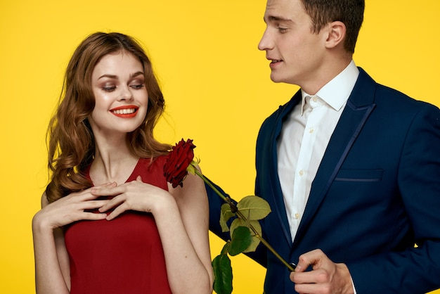 Young couple posing with a rose Premium Photo