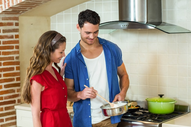 Young couple preparing food together in kitchen at home Premium Photo
