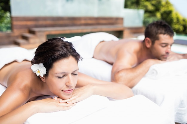 Young couple relaxing on massage table in spa Premium Photo