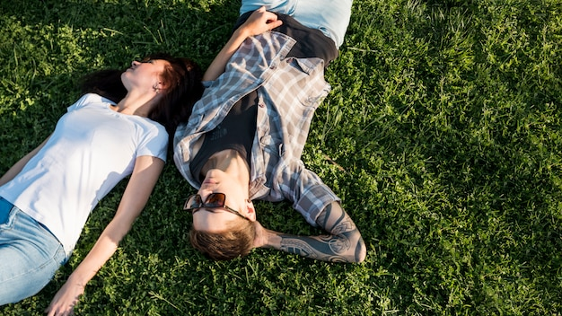 Young couple resting on glade Free Photo