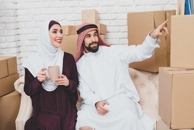 Young couple of saudi arabs got housing new home. Premium Photo