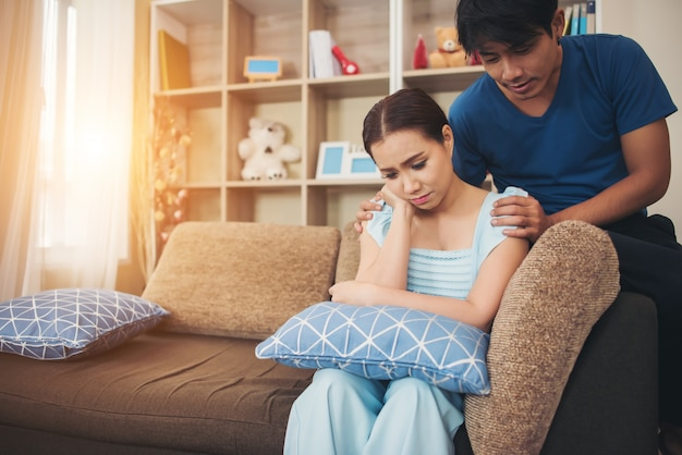 Young couple serious in living room Free Photo