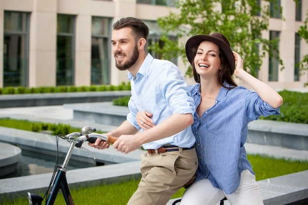 Young couple sitting on a bicycle Free Photo