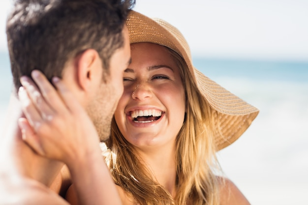 Young couple sitting on sand Premium Photo
