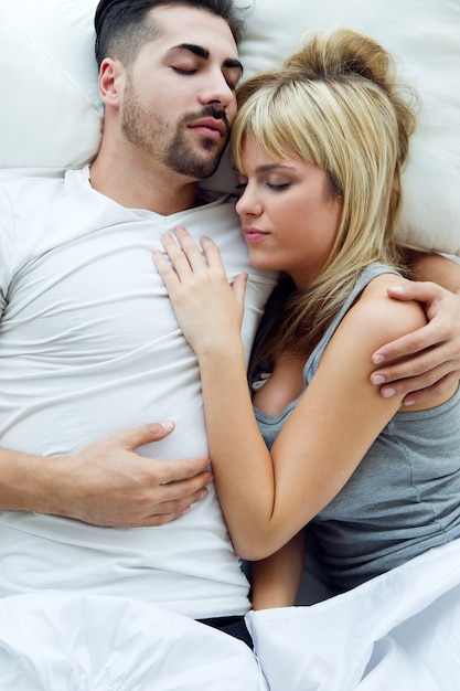 Young couple sleeping in the bed. Free Photo