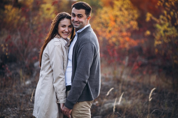 Young couple together in an autumn nature Free Photo
