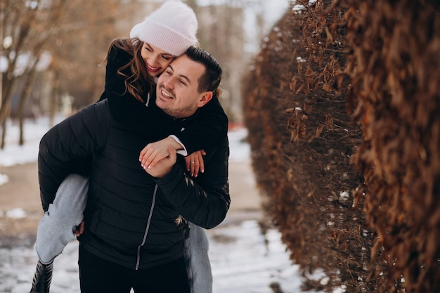 Young couple together in a winter park on valentines day Free Photo