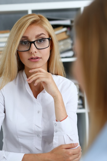 Young couple trying to get loan at bank clerk consultant office. planning future married life social service expectation discussion startup mortgage internal revenue officer visit concept Premium Photo