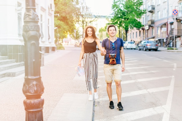 Young couple on vacation in city Free Photo