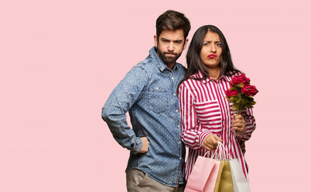 Young couple in valentines day scolding someone very angry Premium Photo