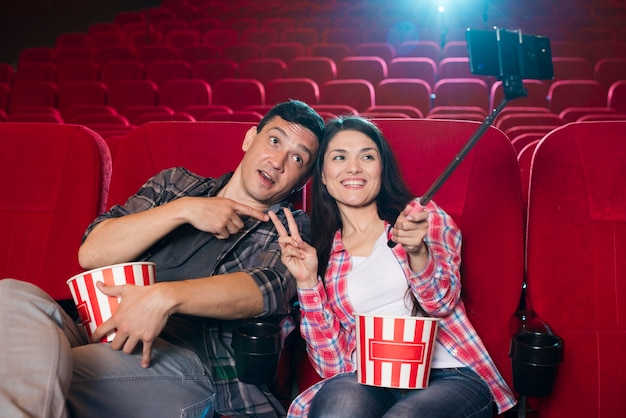 Young couple watching movie in cinema Free Photo