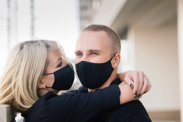 Young couple wearing protective masks in the city Premium Photo