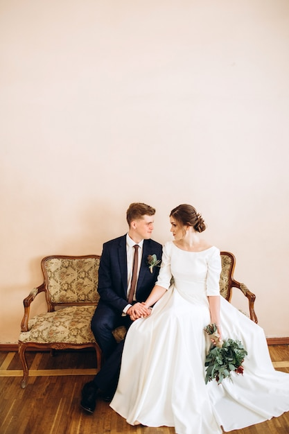 A young couple in wedding dresses in an old mansion. Premium Photo