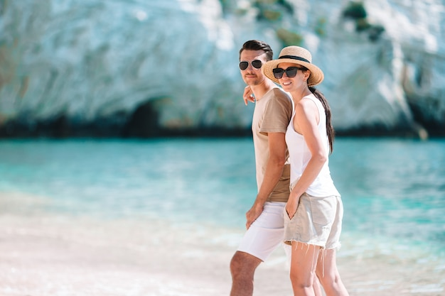 Young couple on white beach during summer vacation Premium Photo