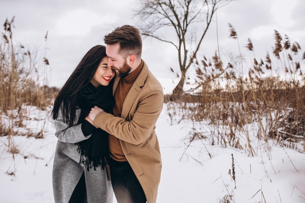 Young couple in winter park Free Photo