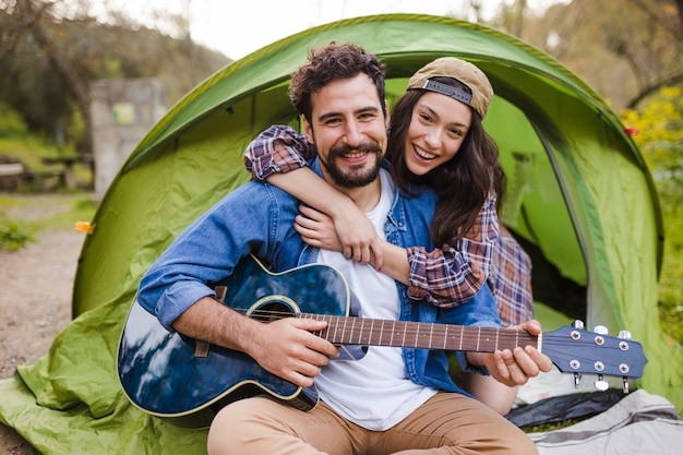 Young couple with guitar Free Photo