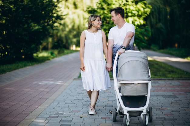 Young couple with their baby daughter in park Free Photo