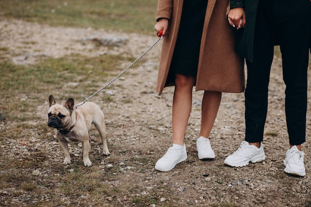 Young couple with their french bulldog in park Free Photo