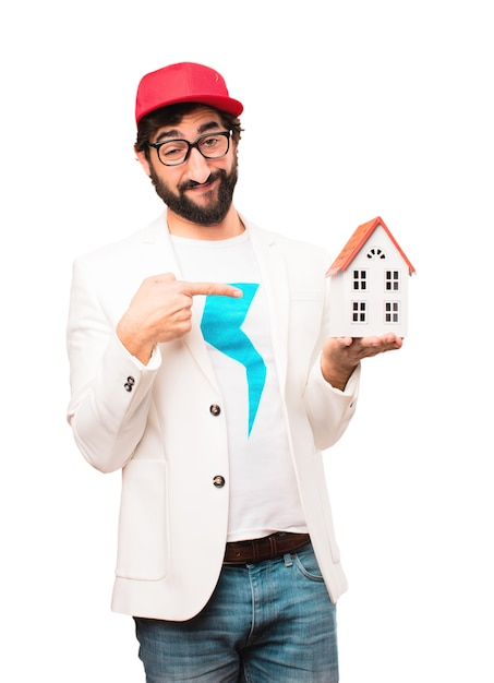 Young crazy businessman with house Free Photo