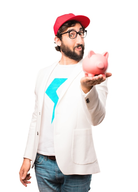 Young crazy businessman with a piggy bank Free Photo