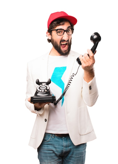 Young crazy businessman with vintage phone Free Photo